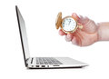 Time control the hand holding a pocket watch side of laptop Stock Image