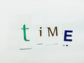 TIme - Cutout Words Collage Of Mixed Magazine Letters with White Background Royalty Free Stock Photo