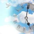 Time flies clock against blue summer sky with flying bird Stock Photo