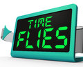 Time flies clock means busy and goes by quickly meaning Stock Photos