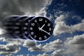 Time flies or speedy time detail of blurred clock face with numbers and hands showing in sky for Royalty Free Stock Images
