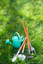 Time for garden now†decorative small gardening tools and sno snowdrops on grass Stock Images