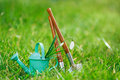 Time for garden now†decorative small gardening tools and snowdrops on grass Stock Photography