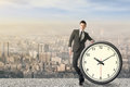 Time manage asian businessman standing with a clock concept of or plan Royalty Free Stock Images