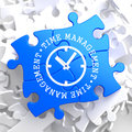 Time management concept on blue puzzle with icon of clock face written pieces business Stock Photography