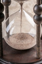 Time is money antique hourglass an ancient showing the passage of Stock Photo
