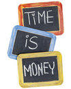 Time is money on blackboard Royalty Free Stock Images