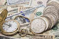 Time money management watch silver dollars savings Royalty Free Stock Photo