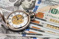 Time is money old watch on dollar banknotes Stock Image