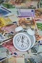 Time is Money with clock and Euro Bank notes Royalty Free Stock Photo
