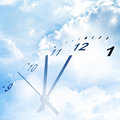 Time passing clock face in blue sky Stock Images