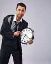 Time is running out worried businessman pointing to his clock Royalty Free Stock Photo