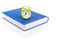 Time for school alarm clock on the book as to concept Stock Photo