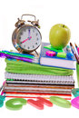 Time for school concept equipment with alarm clock books notes pencils and apple on white Stock Images
