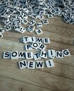 Time for something new in letter tiles wood Royalty Free Stock Photo