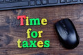 Time for taxes words on table Royalty Free Stock Photo