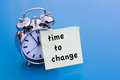 Time To Change on paper with alarm clock Royalty Free Stock Photo