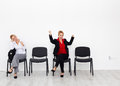 Time to change your attitude and change your life concept with bored excited woman on chairs Royalty Free Stock Photos