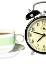 Time to drink coffee alarm clock a cup of on a white background Stock Photos