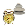 Time to gather stones a alarm clock and pile of pebbles over white background Stock Photography