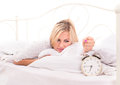 It is time to get up for young blonde woman Royalty Free Stock Photos