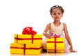 Time to give presents! Young girl with curly hair and yellow gift box on white background Royalty Free Stock Photo