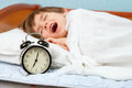 The time to go to school small boy awake by an alarm clock ring Royalty Free Stock Images