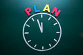 Time to plan concept color word and clock on blackboard Royalty Free Stock Photos