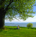 Time to relax vacation for this women she read a book in the garden next the bodensee lake german Stock Images