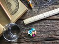Time to take medicine. Pocket watch, Colorful medicine, water glasses, stationery and stationery. On the old wood table, meaning d Royalty Free Stock Photo