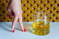 Time of whiskey. A glass of whiskey and a woman`s hand.