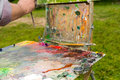 Time-worn painter's sketchbook with multicolored palette outdoor Royalty Free Stock Photo