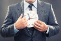 Time young man in a suit holding a clock Stock Photography