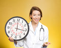Time for your meds closeup portrait female health care professional doctor nurse with stethoscope holding clock and pills reminder Stock Photography