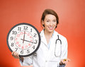 Time for your meds closeup portrait female health care professional doctor nurse with stethoscope holding clock and pills reminder Royalty Free Stock Image