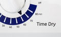Timer on dryer blue and white a set to minutes Royalty Free Stock Images