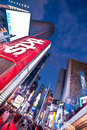 Times square in the evening and night scene of manhattan new york city with tkts sign lit up billboards advertisements thousands Royalty Free Stock Image