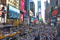 The worlds famous Times Square in New York City day time Royalty Free Stock Photo