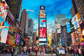 Times square in new york city may with tourists on may iconified as the crossroads of the world it s the brightly illuminated hub Royalty Free Stock Images