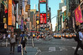 Times square new york intersection of west th street th avenue and west street in daylight Stock Photography