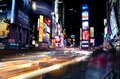 Times square new york at night time with passing traffic Stock Images