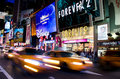 Times square new york at night time with passing traffic Stock Photo