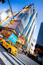 Times square nyc new york city usa jan yellow taxi drives through in midtown manhattan on jan is a major commercial area Royalty Free Stock Image