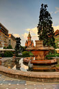 Timisoara romania view of s downtown a little bit after sunrise with the orthodox cathedral towers and the fish fountain Stock Photography