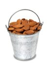 Tin bucket with almonds Stock Photo