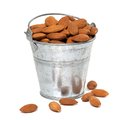 Tin bucket full of almonds Stock Image