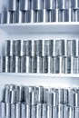 Tin cans stacked on shelves Royalty Free Stock Photos