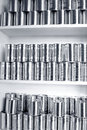 Tin cans stacked on shelves Stock Photo