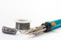 Tin solder and a soldering iron on gas on a white background Royalty Free Stock Photo