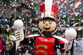 Tin soldier mascot under explosion of confetti Royalty Free Stock Photography